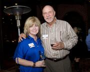Debbie Struhm of Roebbelen Contracting and Tom Struhm of The Recognition Group pose at the Sacramento Regional Builders Exchange mixer.