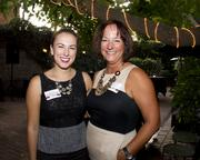 Kelly O'Brien of the Sacramento River Cats and Karen O'Brien of International Pro Insurance pose at the Sacramento Regional Builders Exchange mixer.