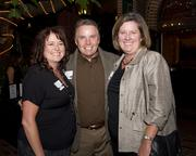 Kathleen Mitchell of KM Events and Virginia Smyth and Phil Smyth of Shephard Mechanical Contractors pose at the Sacramento Regional Builders Exchange mixer.