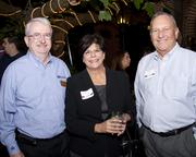 Bruce Stimson of Roebbelen Contracting, Sandra Graham of DPR Construction and Larry Cook of Airco Mechanical pose at the Sacramento Regional Builders Exchange mixer.