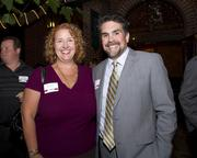 Carrie Bushman and Steve McCutcheon of Cook Brown LLP pose at the Sacramento Regional Builders Exchange mixer.