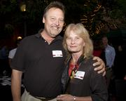 Dave Fitkin of LJ Roy Associates and Linda Rhyme of Landmark Construction pose at the Sacramento Regional Builders Exchange mixer.
