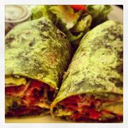 BLTA wrap: bacon, lettuce, tomato, avocado in a spinach wrap