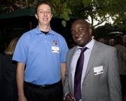 James Willsie of HGA Architects and Finnegan Mwape of Twining pose at the Sacramento Regional Builders Exchange mixer.