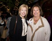 Anne Marie Schubert, Supervising Deputy District Attorney and Susan Peters, Sacramento County Supervisor, pose at the Sacramento Regional Builders Exchange mixer.
