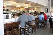 Taste of Belgium on Short Vine has an open kitchen, where customers can sit and watch waffles and crepes being made.