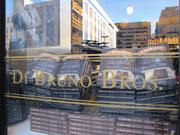 """A window at Di Bruno Bros. features the book, """"House of Cheese,"""" by Tenaya Darlington."""