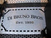 With a nod to its Italian Market roots, Di Bruno Bros.' new store has a mosaic name plate in the entry way.