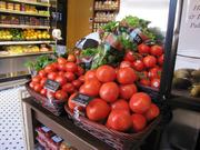 Tomatoes and basil are displayed prominently.