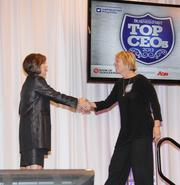 Jennifer Thomas, chairman and CEO of Bank of Albuquerque, greets honoree Mary Domito