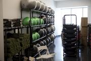 Fitness supplies are stored in a large area near the workout area.