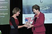 From right, CFO of the Year honoree Mary Pierson receives her award from Carolyn M. Jones, publisher of the Albany Business Review. Pierson is senior vice president and CFO of Capital District YMCA.