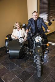 Carrie Martz and Parsons on one of Parsons' motorcycles.