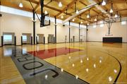 Not surprisingly, the NBA Hall of Famer's compound includes an indoor basketball court.