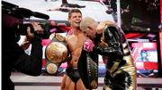 Goldust, right, won the WWE tag team championship Oct. 14 while wearing Under Armour gloves. His half-brother Cody Rhodes, left, is his partner.