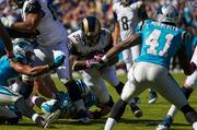 St. Louis Rams running back Zac Stacy braces for impact from Carolina Panthers defenders.