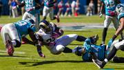 St. Louis Rams running back Zac Stacy is brought down hard by Carolina Panthers defenders.