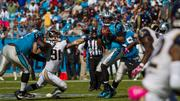 St. Louis Rams defensive end Chris Long tries to beat his blocker and reach Carolina Panthers quarterback Cam Newton. Long was ejected in the third quarter for throwing a punch.