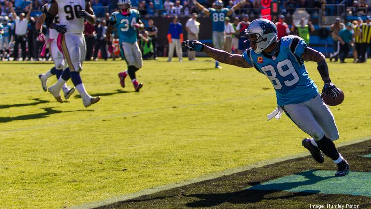 Carolina Panthers wide receiver Steve Smith exults as he crosses into the end zone for a touchdown during an October 2013 game against the St. Louis Rams.