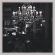 The chandelier-lit dining room on a Friday night