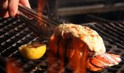The menu also includes burgers, chicken, ribs and seafood, such as lobster on the grill.