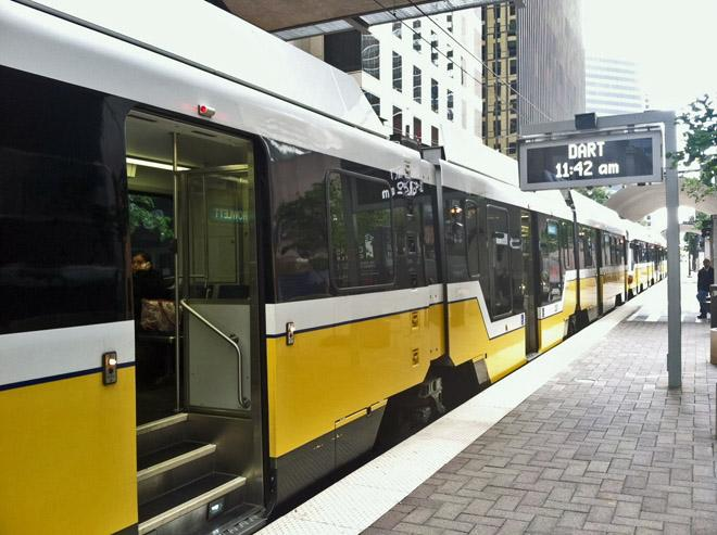 A DART train arrives at the St. Paul station in downtown Dallas.