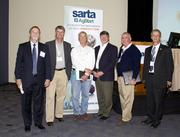 Posing for a group shot at the SARTA CleanStart/AgStart Showcase: John Cushing, vice president of SSA Marine, Port of Sacramento; Bob Adams of the UC Davis Sustainable AgTech Innovation Center; Bill Reinert, coordinator, Ag R&D for Morning Star Co.; Tim Johnson, president and CEO, California Rice Commission and Michael Maulhardt, associate with the California Institute of Food and Agricultural Research.