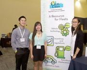Raymond Chiang, Christine Hoang and Stella Yip, Clean Cities staff from the city of Sacramento, stand at their exhibit at the SARTA CleanStart/AgStart Showcase.
