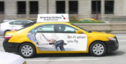 American Airlines' new ad campaign in Chicago includes taxis wrapped with AA messaging.