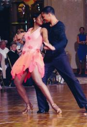 Ola Sage participated in an Arthur Murray dance competition in the early 2000s.