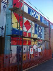 "Bank of America's Sausalito branch includes a mural using international maritime signal flags to spell""Bank of America Sausalito CAL"" The mural was recently discovered under wood planks during a termite remediation project."