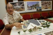 Glenn Miura, Principal of CDS International, shows a model of the Aiea Public Library and how plans for greenery and the landscaping compliment the architecture, giving it a Hawaiian sense of place.