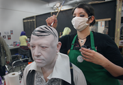 Baron Von Goolo's butler gets his comb-over courtesy of makeup artist Kyna Martain.