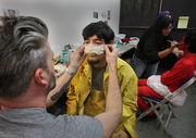 Frog Fish Man John Doherty gets made up by Adam Gouthwaite.