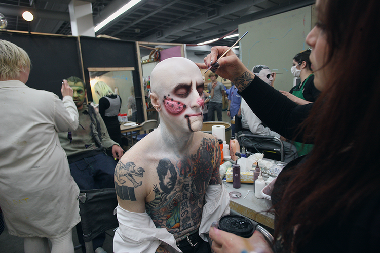 Meet Snakie: private security guard by day, mutant by night. Snakie has been scaring FrightTown guests for a decade. Here, makeup artist Amber Arpin puts on the finishing touches. Click through the gallery for more behind-the-scenes photos of Portland's largest haunted house.