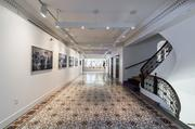 A long hallway at 21c Museum Hotel in Cincinnati features several pieces of framed artwork.