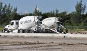 Trucks with the Tarmac and Titan America names are pouring footers. Tarmac is owned by Titan America and is being transitioned to that name.