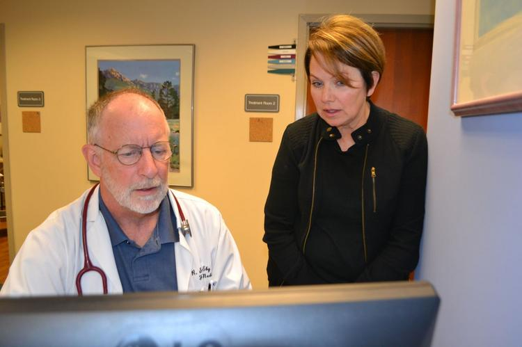 Dr. Stephen Eby, left, is the assistant medical director at the Good Samaritan Free Health Center in East Price Hill. He works with registered nurse and clinic manager Linda Smith-Berry.