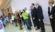 The Millenia Microsoft Store manager stands with local representatives before the ribbon cutting.