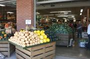 Produce is stocked outside the store.