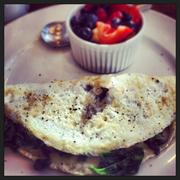 White omelet with spinach, tomatoes, mushrooms and Swiss