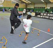Defensive back Will Blackmon works out with a child at Oakington Manor Primary school in Brent, London.