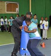 Jags offensive lineman Cameron Bradfield during a football/cheerleader coaching clinic.