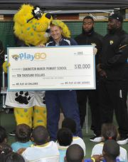 Oakington Manor Primary School in Brent, London Receive a check for $10,000 to inspire the children to stay active. The San Francisco 49ers will play the Jacksonville Jaguars in game two of the NFL International Series at Wembley Stadium in London on Sunday, Oct. 27.