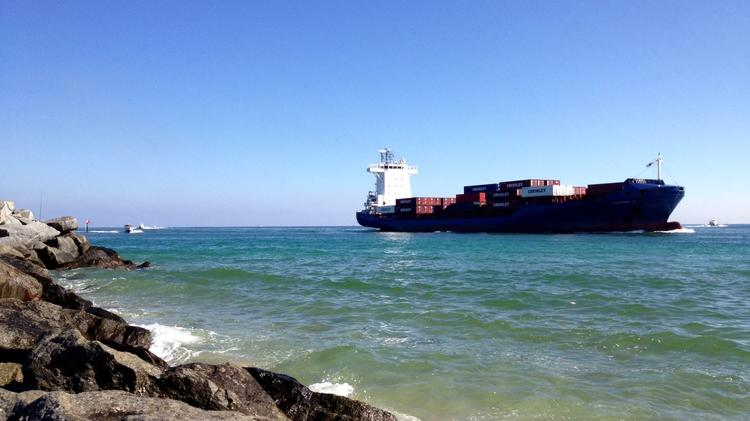 A ship enters the inlet at Port Everglades.
