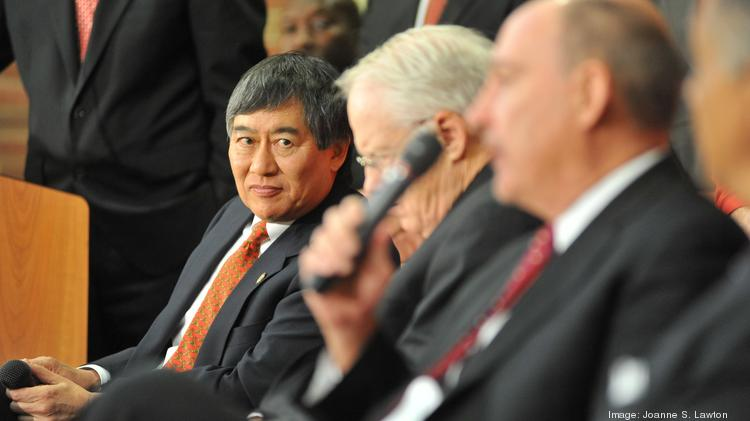 University of Maryland President Wallace Loh, left, at a 2012 news conference to announce Maryland's decision to move to the Big Ten.