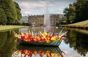 A piece from a private sale entitled 'Sunset Boat' by Dale Chihuly, seen on the lake at Chatsworth House in Derbyshire, U.K., in 2006.
