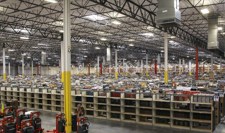 A buildup in inventory played a big role in third-quarter economic growth. Shown here is merchandise at Amazon's Phoenix Fulfillment Center.