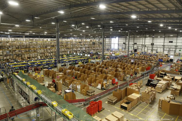 Employees process customer orders at an Amazon fulfillment center in the United Kingdom.