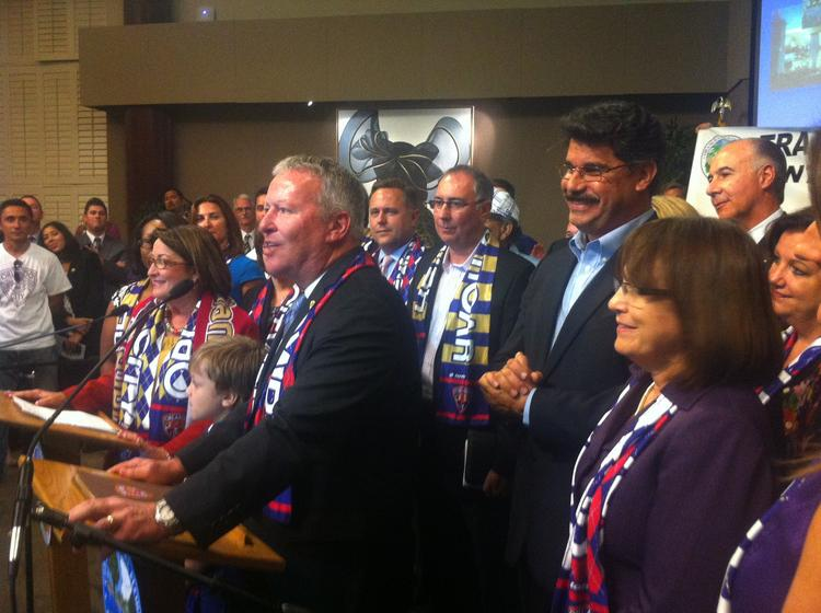 Orange County Mayor Teresa Jacobs (left) stands with Orlando Mayor Buddy Dyer (right) after Orange County leaders approved the $94.5 million venues package that will include funding for a soccer stadium in downtown Orlando.
